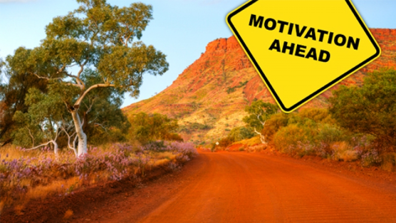 "Australian Road with ""Motivation Ahead"" sign"